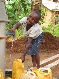 Child drawing water from a tap