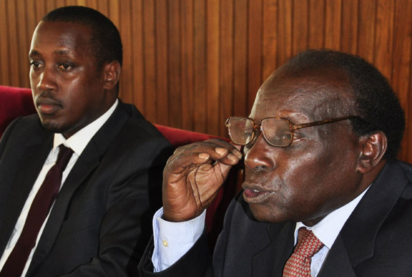 Western youth MP Gerald Karuhanga and his lawyer, Mr George Kanyeihamba, PHOTO BY GEOFFREY SSERUYANGE