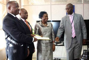 Ready for business: (Left to right) Centenary bank MD Fabian Kasi, dfcu MD Juma Kisaame, Finance Minister Maria Kiwanuka, and Stanbic bank MD Philip Odera after the signing of the MoU. Photo by Faiswal Kasirye.