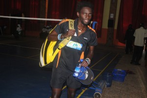 Africa's top seed Edwin Ekiring leaves Nsambya Sharing Hall after being shown the exit by Italian Wisnu Aryo Putro on Friday. PHOTO BY EDDIE CHICCO.