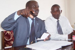 Fufa publicist Rogers Mulindwa (Left) addressing the Press recently